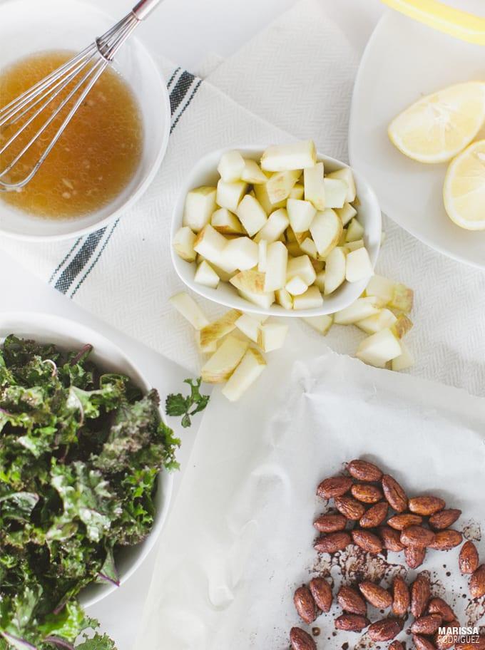 ingredients for a vegan kale salad- fuji apple toasted almonds